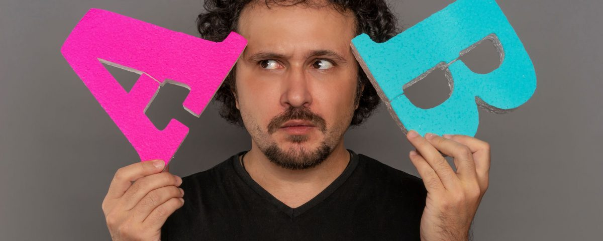 Man Holding 3D Letters 'A' and 'B' next to his head